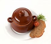 foto of pot roast  - roast with greens and tomato in a brown clay pot - JPG