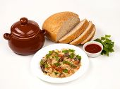 pic of pot roast  - roast with greens sauce bread and tomato in a brown clay pot - JPG