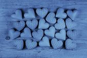 Blue hearts on an old wooden background: greeting card for fathers day.