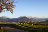 picture of annecy  - Overview of Annecy city lake and snowed mountains in france - JPG