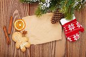 Christmas food and decor with snow fir tree background with paper for copy space