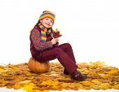 girl on autumn leaves studio shoot on white