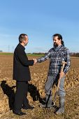 Cooperation Between A Businessman And A Farmer