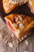 Piece Of Pear Tart With Almonds On A Plate Close Up Vertical