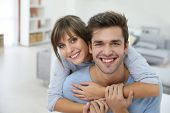 Happy young couple moving together in new apartment