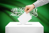Voting Concept - Ballot Box With National Flag On Background - Saudi Arabia