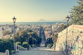 picture of descending  - Staircase descending into a city Patras Greece - JPG