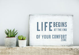 picture of sign-boards  - motivational poster quote LIFE BEGINS AT THE END OF COMFORT ZONE - JPG