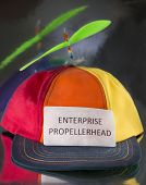 """image of enterprise  - Colorful hat with green propeller with sign that says, """"Enterprise Propellerhead"""" ** Note: Shallow depth of field - JPG"""