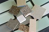 pic of tile  - Glass subway tile samples used in kitchen backsplashes and quartz samples for countertops - JPG