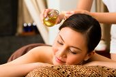 image of ayurveda  - Chinese Asian woman in wellness beauty spa having aroma therapy massage with essential oil - JPG