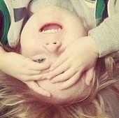 image of peek  - Upside down toddler boy playing peek a boo - JPG