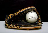 pic of fastpitch  - A slowpitch softball mitt with a white slowpitch softball - JPG