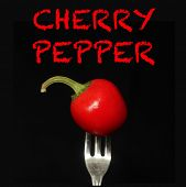 picture of black-cherry  - Cherry pepper on a fork on a black background - JPG