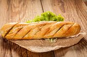 picture of butter-lettuce  - Garlic baguette with lettuce on a wooden table - JPG
