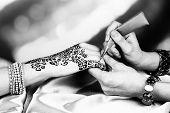 pic of mehndi  - Process of applying Mehndi on female hand - JPG