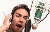 foto of singing  - handsome brunette man singing in music studio - JPG