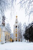 picture of uglich  - White and yellow church in winter in Uglich - JPG