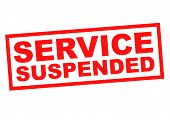 picture of suspenders  - SERVICE SUSPENDED red Rubber Stamp over a white background - JPG