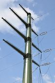 stock photo of power transmission lines  - Transmission power line against the blue sky - JPG