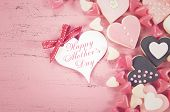 stock photo of special day  - Happy Mothers Day gift of pink heart shape cookies with sample text and applied retro vintage style filters - JPG