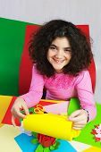picture of ten years old  - Ten Year Old Girl with Decorations and Colorful Paper. ** Note: Visible grain at 100%, best at smaller sizes - JPG