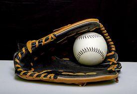 image of softball  - A slowpitch softball mitt with a white slowpitch softball - JPG