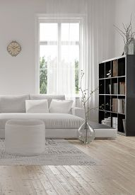 stock photo of ottoman  - Corner of a comfortable white modern living room with an upholstered sofa and ottoman on a wood floor and bookcase full of books alongside a tall window - JPG