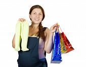 stock photo of babygro  - pregnant woman with shopping bags and children - JPG