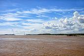 stock photo of bolivar  - Bridge across brown waters of Orinoco river in Sudad Bolivar - JPG