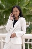 Business Woman With Cell Phone Laughing