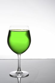 foto of champagne color  - Colorful green juice fruit on champagne glass still life shooting  - JPG