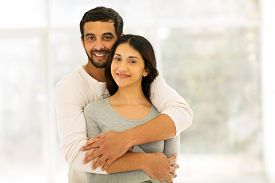 image of indian  - romantic indian couple hugging at home - JPG