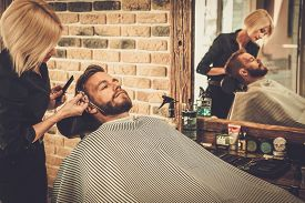 stock photo of moustache  - Client during beard and moustache grooming in barber shop - JPG