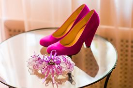 stock photo of garter-belt  - Luxury wedding shoes - JPG