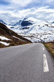 picture of long winding road  - road at the norwegian mountains at Norway - JPG