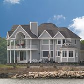 Large House Build On Beach Of Ocean Or Lake