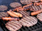 image of hot dogs  - Hamburg patties and hot dogs on a park grill - JPG