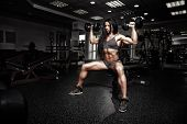 Sexy Fitness Woman In Sport Wear With Perfect Fitness Body In Gym Performing Shoulder Exercises With poster
