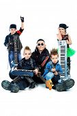 Heavy metal musician  with a group of stylish children. Shot in a studio. Isolated over white backgr