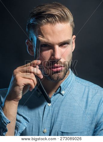 Bearded Man Having Shave With