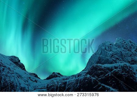 Aurora Borealis Above The Snow
