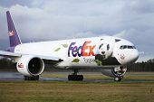 EDINBURGH, SCOTLAND, UK - DECEMBER 4: A Fedex Panda Express just seconds after landing at Edinburgh Turnhouse Airport carries two Giant Pandas Tian Tian and Yang Guang to Edinburgh Zoo in Edinburgh, Scotland, UK on Dec. 4, 2011.