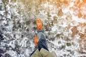Walk On Wet Melted Ice Pavement. First Person View On The Feet Of A Man Walking Along The Icy Paveme poster
