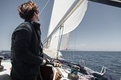 Sailor Sets Sail On A Sailing Yacht. poster