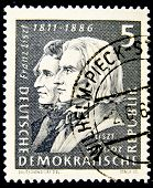 GERMANY - CIRCA 1986: a stamp printed in Germany shows image of Franz Liszt and Hector Berlioz, circa 1986