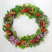 Herb and spice wreath with a selection of dried and fresh herbs and  flowers on rustic wood backgrou poster