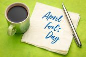 April Fools Day -handwriting on a napkin with a cup of coffee poster