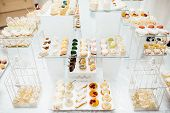 Table With Different Sweets For Party. Candy Bar. poster
