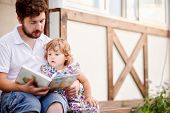 Lifestyle, Handsome Father Read A Book To His Cute Little Daughter Outdoors, Warm Summer Day, Family poster
